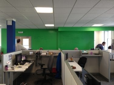 New completed office with green dry erase board wall