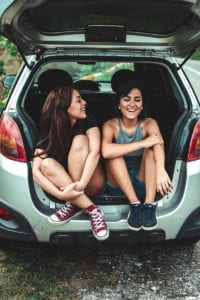 Two women in the back of a car