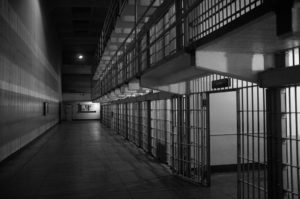 Inside of a prison showing multiple cells